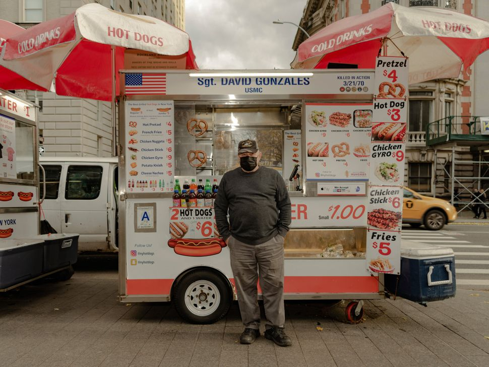 """Danny Rossi is a disabled Vietnam veteran who has been running a hot dog cart in front of the Met for 13 years with his daughter Elizabeth. During some nights of lockdown, he slept in the van next to his cart, fearing someone would try to take over his prized spot. """"We would sell 400 hot dogs a day. Now, maybe a tenth of that. But we keep working and waiting."""""""