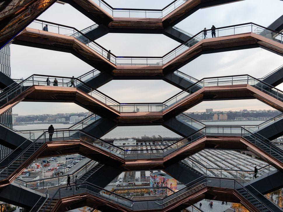 People walking through the Vessel structure at the Hudson Yards in Manhattan.