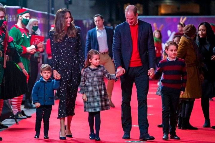 The Duke and Duchess of Cambridge, along with their three children, arrive for a special pantomime performance at London's Pa