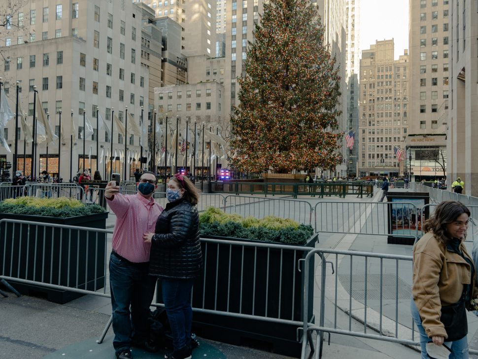 A couple takes a selfie with the Christmas tree at Rockefeller Center.