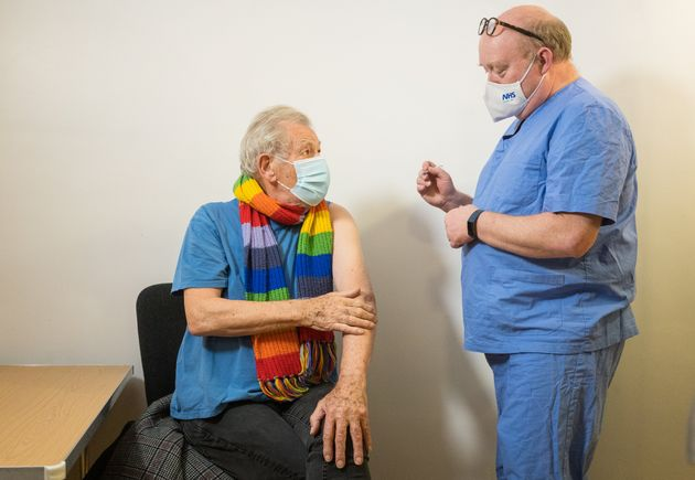 Sir Ian McKellen receives the first of two Covid-19 jabs at Queen Mary University