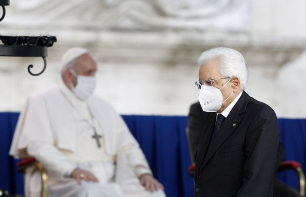 ROME, ITALY - OCTOBER 20: Italian President Sergio Mattarella (R) wears a protective mask as he walks...