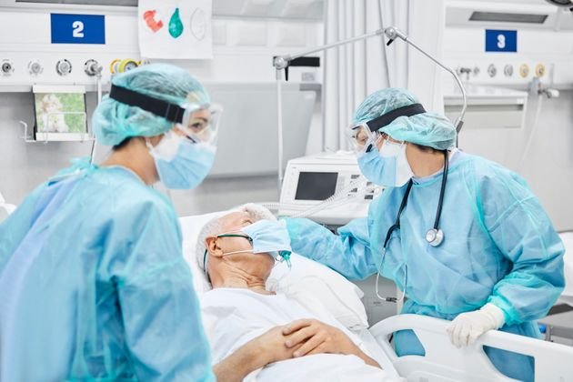 Doctors are seen caring for a patient in a stock