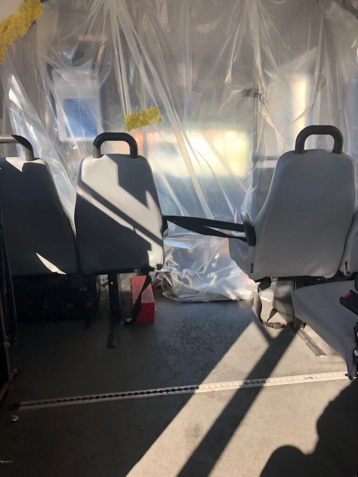 Plastic sheeting inside the van separated the author from the driver.