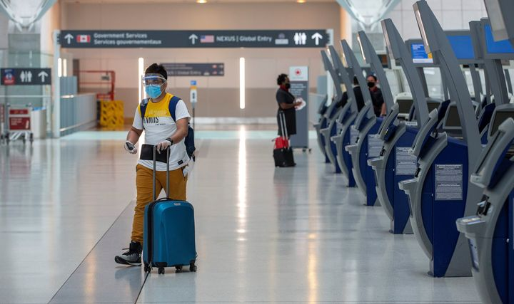 A passenger crosses an empty terminal at Toronto Pearson International Airport, June 23, 2020. Canada's population has all but stopped growing amid the COVID-19 pandemic, new data from Statistics Canada shows.