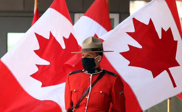 A Royal Canadian Mounted Police officer stands guard outside the Senate of Canada prior to the Speech...