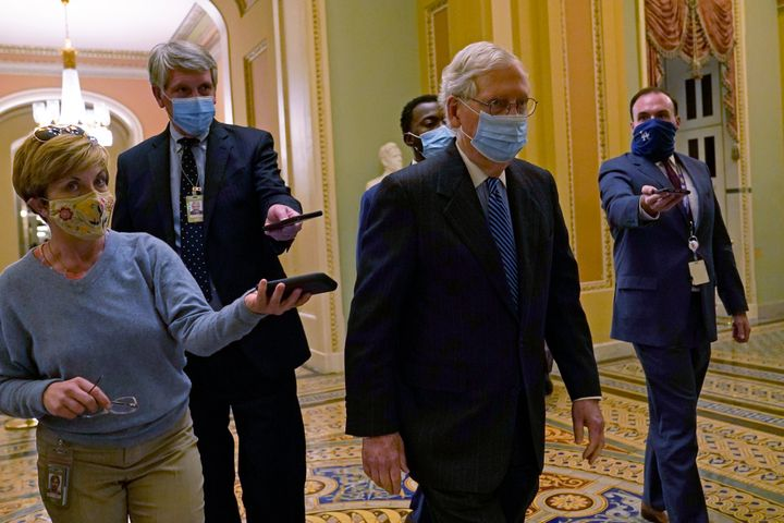 Senate Majority Leader Mitch McConnell of Ky., walks past reporters on Capitol Hill in Washington, Tuesday, Dec. 15, 2020. (A