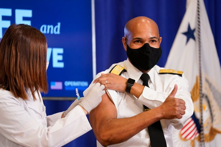 Surgeon General Jerome Adams receives a Pfizer-BioNTech COVID-19 vaccine shot at the Eisenhower Executive Office Building on