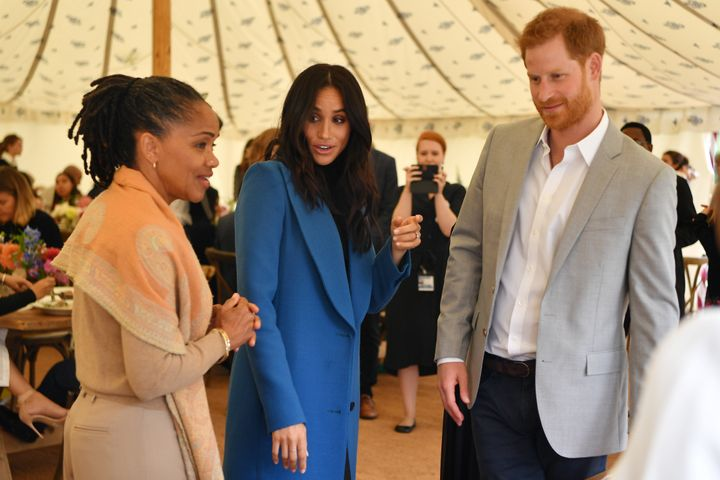 Meghan, Duchess of Sussex; her mother, Doria Ragland; and Prince Harry at the launch of a charity cookbook, at Kensington Palace in London, September 20, 2018.