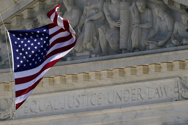 An American flag waves in front of the Supreme Court building, Monday, Nov. 2, 2020, on Capitol Hill in Washington. (AP Photo