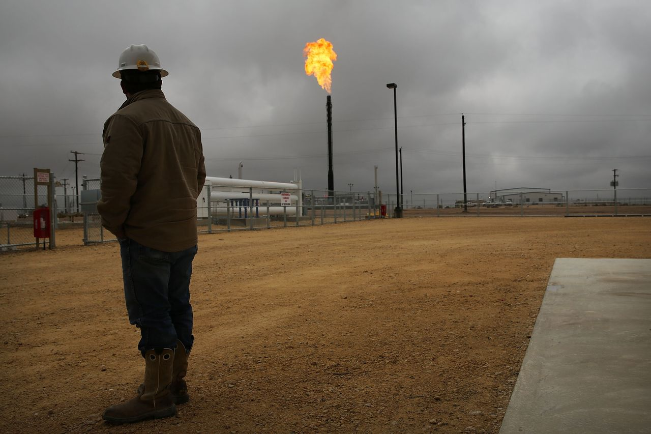 Flared natural gas is burned off at Apache Corporations' operations at the Deadwood natural gas plant in the Permian Basin, Garden City, Texas. To meet climate pledges, fossil fuel production must drop by 6% a year for the next decade.