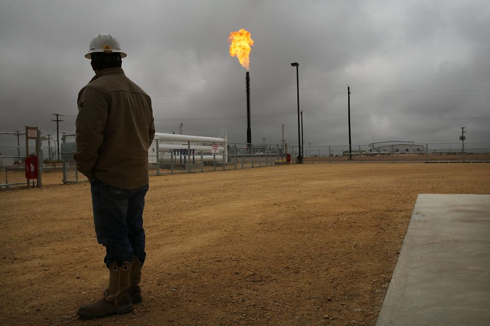 Flared natural gas is burned off at Apache Corporations' operations at the Deadwood natural gas plant...