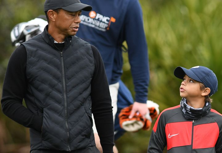 Tiger Woods and son Charlie talk things over at the 10th hole during a pro-am practice round before the PNC Championship.