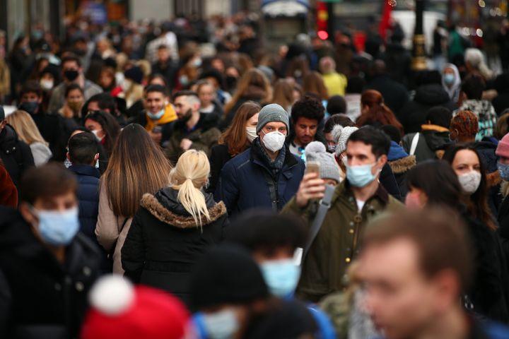 Shoppers walk along a busy Oxford Street in London.
