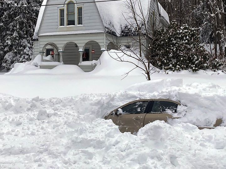 This photo, provided by the New York State Police, shows a car, in Owego, NY, from which a New York State Police sergeant res
