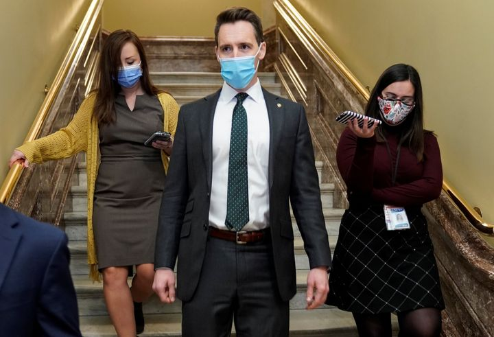 Sen. Josh Hawley (R-Mo.) threatened to block a short-term government spending bill Friday if he doesn't see progress on large