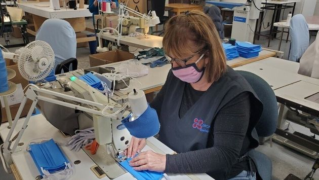 A CORCAN worker sews a face mask in a April 30, 2020 photo shared by the Correctional Service of
