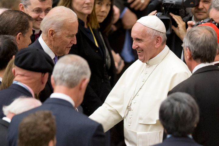 Then-Vice President Joe Biden shakes hands with Pope Francis during a conference in April 2016 on cancerresearch at the