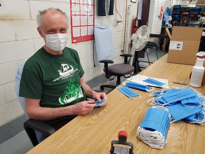 A CORCAN worker assembles face masks in a photo dated April 30, 2020.