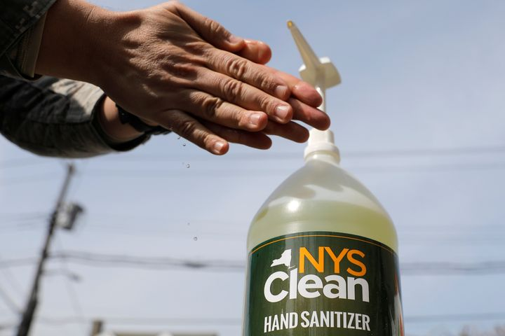 A member of the New York Army National Guard uses NYS Clean, a hand sanitizer created by the New York state government via prison labour in response to the coronavirus disease in New Rochelle, New York on March 18, 2020.