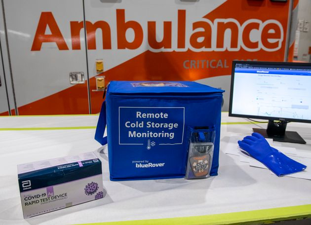 A Remote Cold Storage Monitoring insulated container for transporting COVID-19 vaccines sits in front...