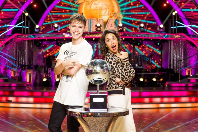 HRVY and Janette Manrara pose with the glitterball