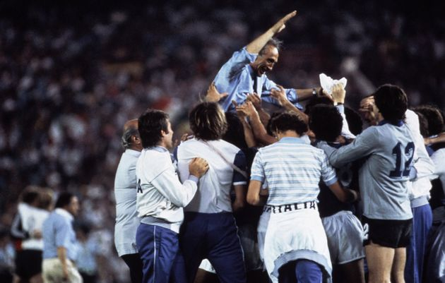 Italian coach Enzo Bearzot is lifted up on shoulders in celebration by players and fans after Italy had...