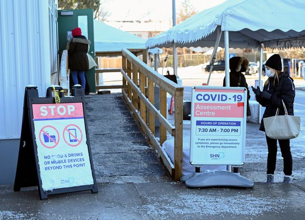People line up at a COVID-19 assessment center on Dec. 2, 2020, in Scarborough,