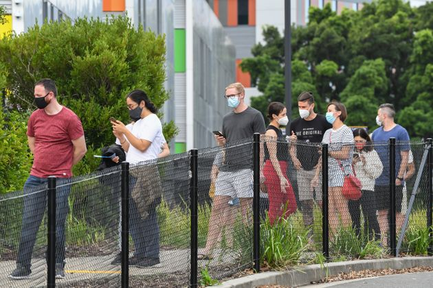 Members of the public wait in line for a COVID-19 test on Sunday evening at Royal North Shore hospital...