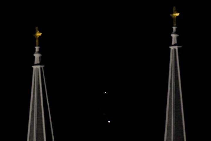 Saturn, top, and Jupiter, below, are framed between the twin steeples of St. Joseph Catholic Church Saturday, Dec. 19, 2020 in Topeka, Kansas, USA.