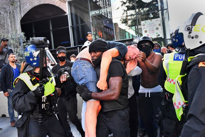 Patrick Hutchinson carries an injured far-right counterprotester named Bryn Male to safety near London's Waterloo station during a Black Lives Matter protest, following the police killing of George Floyd, on June 13.