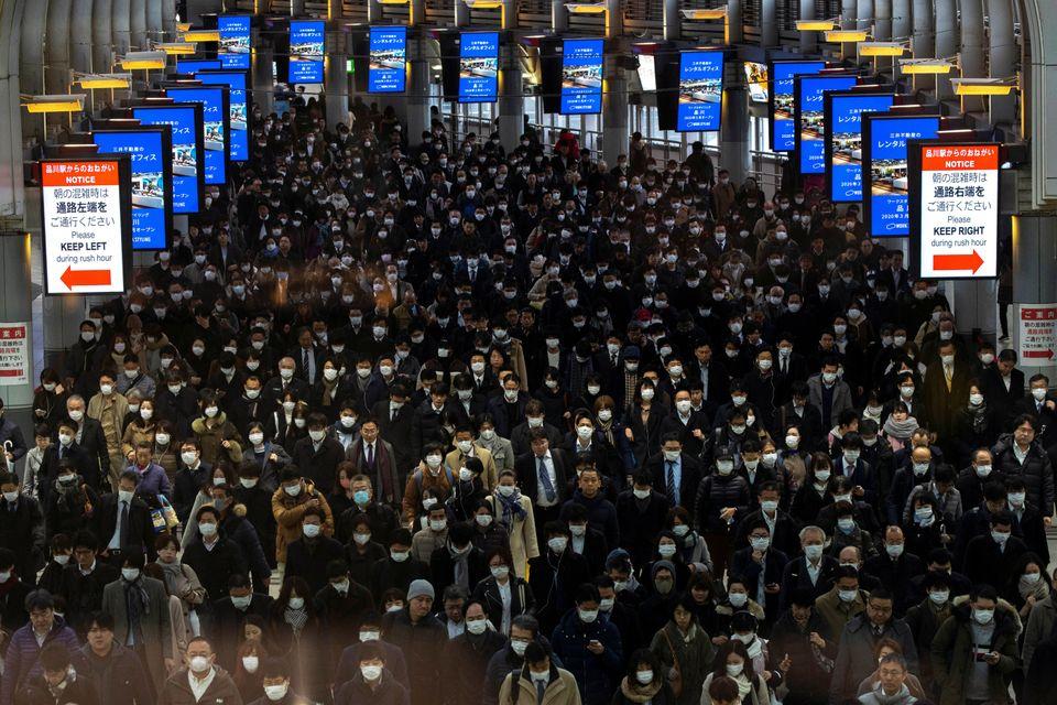 Crowds at Tokyo's Shinagawa station in Japan on March