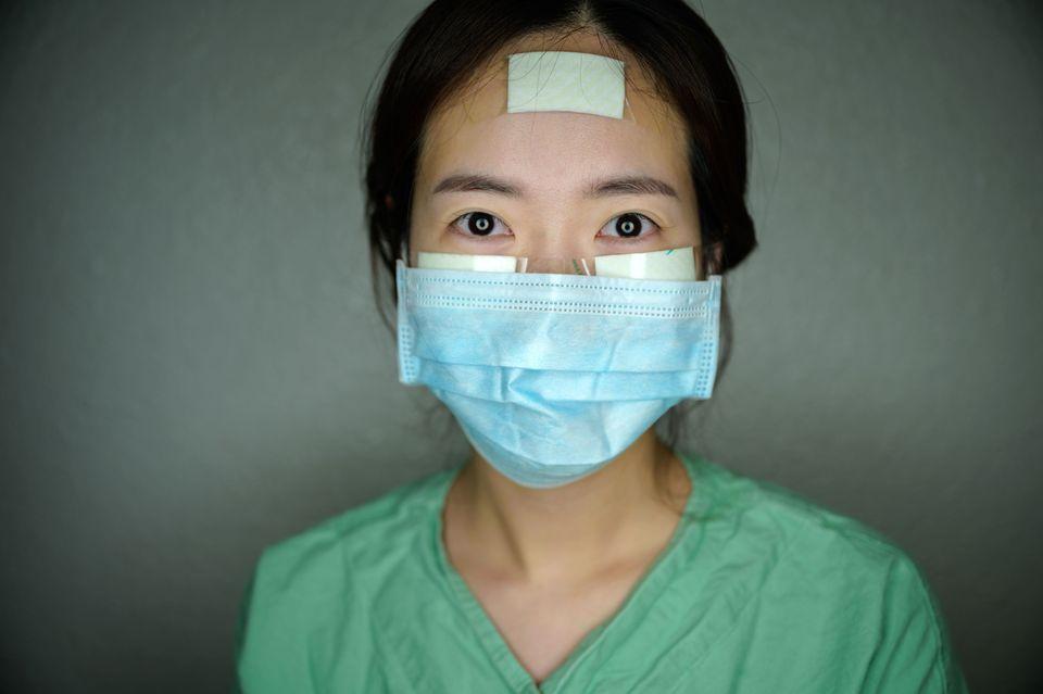 Nurse Yun Na-yong poses during a break between shifts at Keimyung University hospital in Daegu, South...