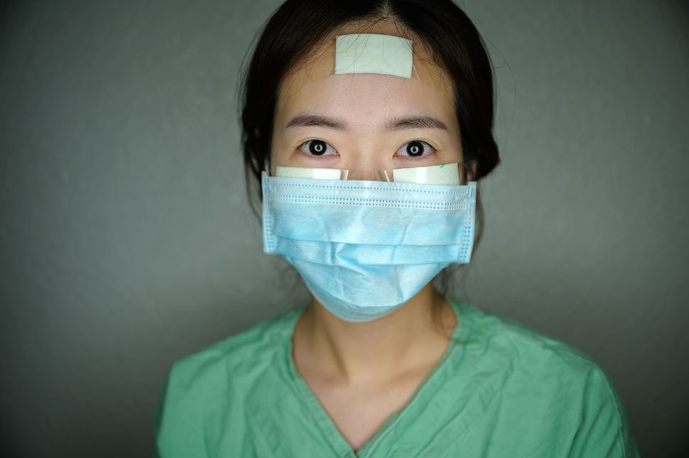 Nurse Yun Na-yong poses during a break between shifts at Keimyung University hospital in Daegu, South Korea, on March 12