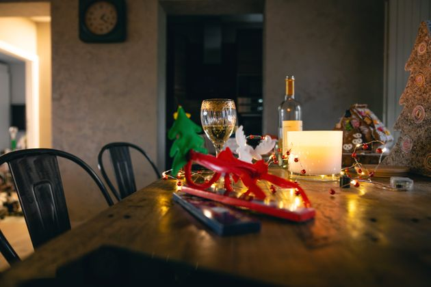 Decorated wooden table with a glass of wine on