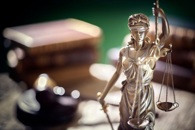 Legal and law concept statue of Lady Justice with scales of justice and judge