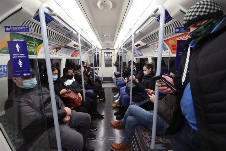 Commuters travelling on the morning rush hour in London, which has moved into the highest tier of coronavirus restrictions as a result of soaring case rates.