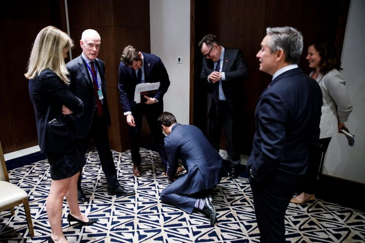 """""""PM Trudeau helps out advisor Patrick Travers by tying his shoelace,"""" said Scotti, who took the photo in Addis Ababa on Feb. 10, 2020."""