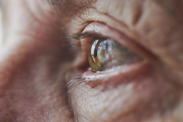 Macro / close-up image of female senior's eyeball, surrounded by aged, wrinkled