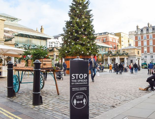 A 'Stop The Spread Of Coronavirus' sign seen in Covent Garden Market in