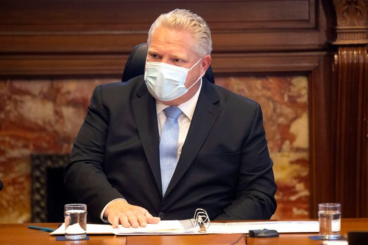Ontario Premier Doug Ford, right, speaks during a meeting in Toronto on Dec. 4, 2020.