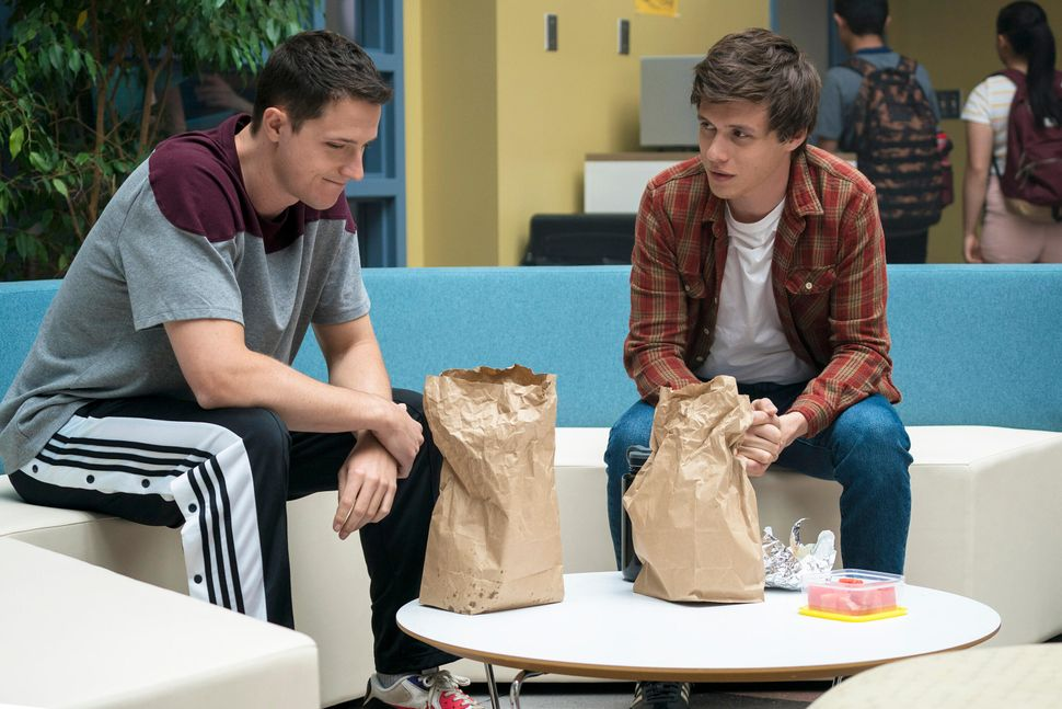 Shane Harper as Logan Davis and Nick Robinson as Eric Walker.