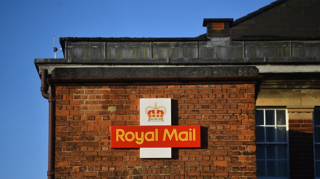 STAFFORD, ENGLAND - NOVEMBER 22: The Royal Mail logo is seen outside a Delivery Office on November 22,...