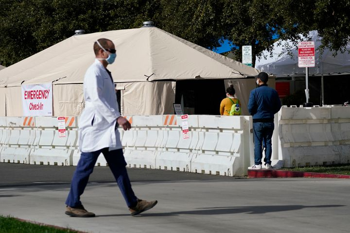 A medical worker passes a medical tent outside the emergency room at UCI Medical Center in Irvine, Calif. on Thursday. Califo