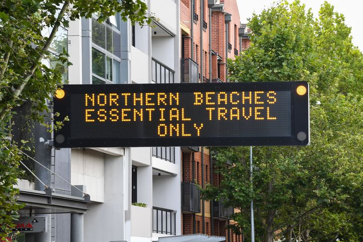 Digital road signs warn against travel to the Northern Beaches in the suburb of Crows Nest on December 20, 2020 in Sydney.