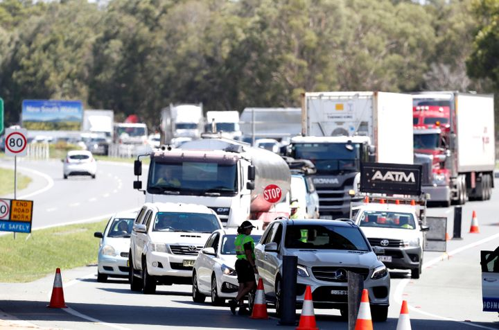 Long queue of motorists who are entering Queensland from New South Wales through the border checkpoint on December 21, 2020 in Coolangatta, Gold Coast, Australia.