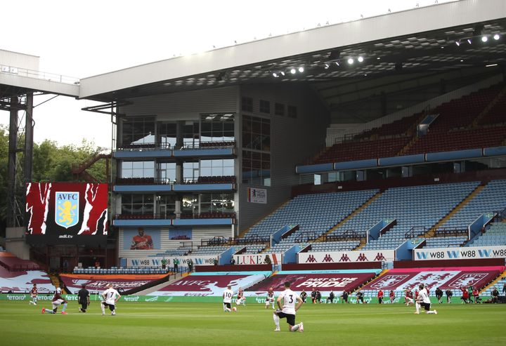 Players of Aston Villa and Sheffield United take a knee in support of the Black Lives Matter movement prior to the Premier League soccer match between the two teams at Villa Park on June 17 in Birmingham, England.
