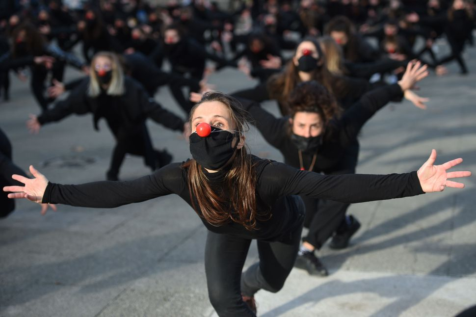 "One hundred eighty performers from the group ""Les Essentiels"" dance on Dec. 12 in Montpellier to protest against the governme"