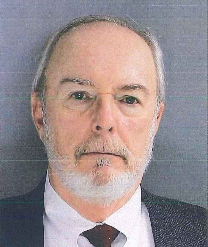 Bruce Bartman, 70, was arrested on Friday and charged withtwo counts of perjury and one count of unlawful voting after