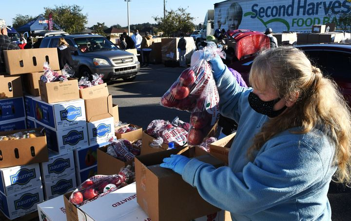 A volunteer prepares boxes of food assistance at a food distribution event in Groveland, Florida, on Dec. 9.
